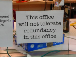 Sign: This office will not tolerate redundancy in this office